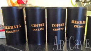 spray painted reclaimed coffee cans